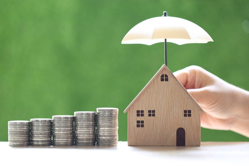 protection-stack-coins-money-model-house-with-hand-holding-umbrella-natural-green-background-finance-insurance-safe-investment-concept.jpg